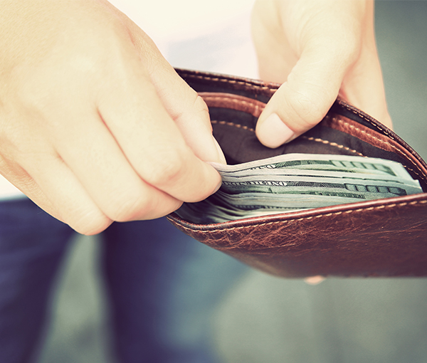 Man with wallet pulling out money